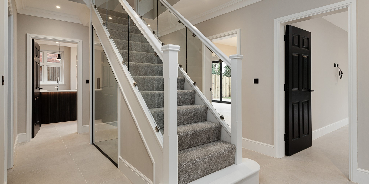 white primed and glass staircase