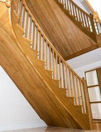 Pair of curved stairs in American white oak