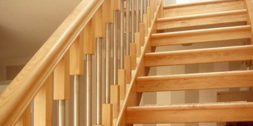 Hemlock staircase with modern metal spindles