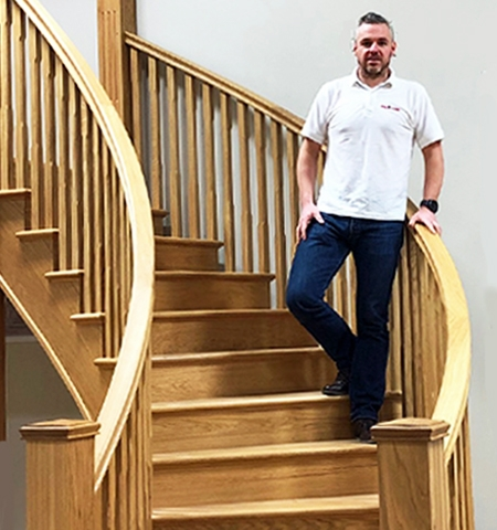 Pear Stairs purchasing manager Andy Griffiths tries out one of our curved oak staircases as he prepares for the London Marathon
