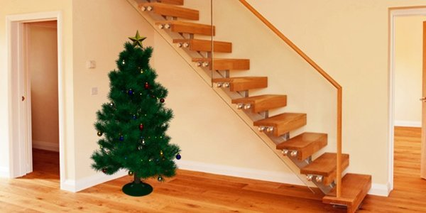 Oak and glass stairs with Christmas tree