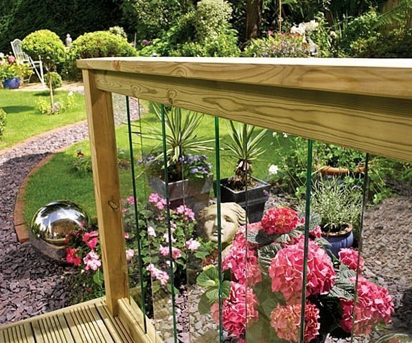 Decking balustrade with glass