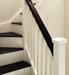 White stairs with dark sapele treads and handrail