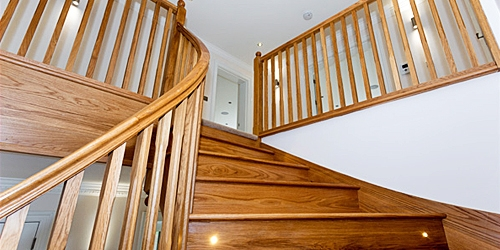 Curved oak staircase by Pear Stairs
