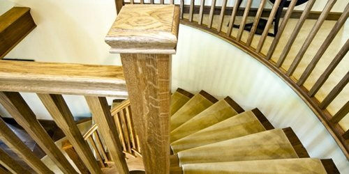 Top of curved oak staircase by Pear Stairs