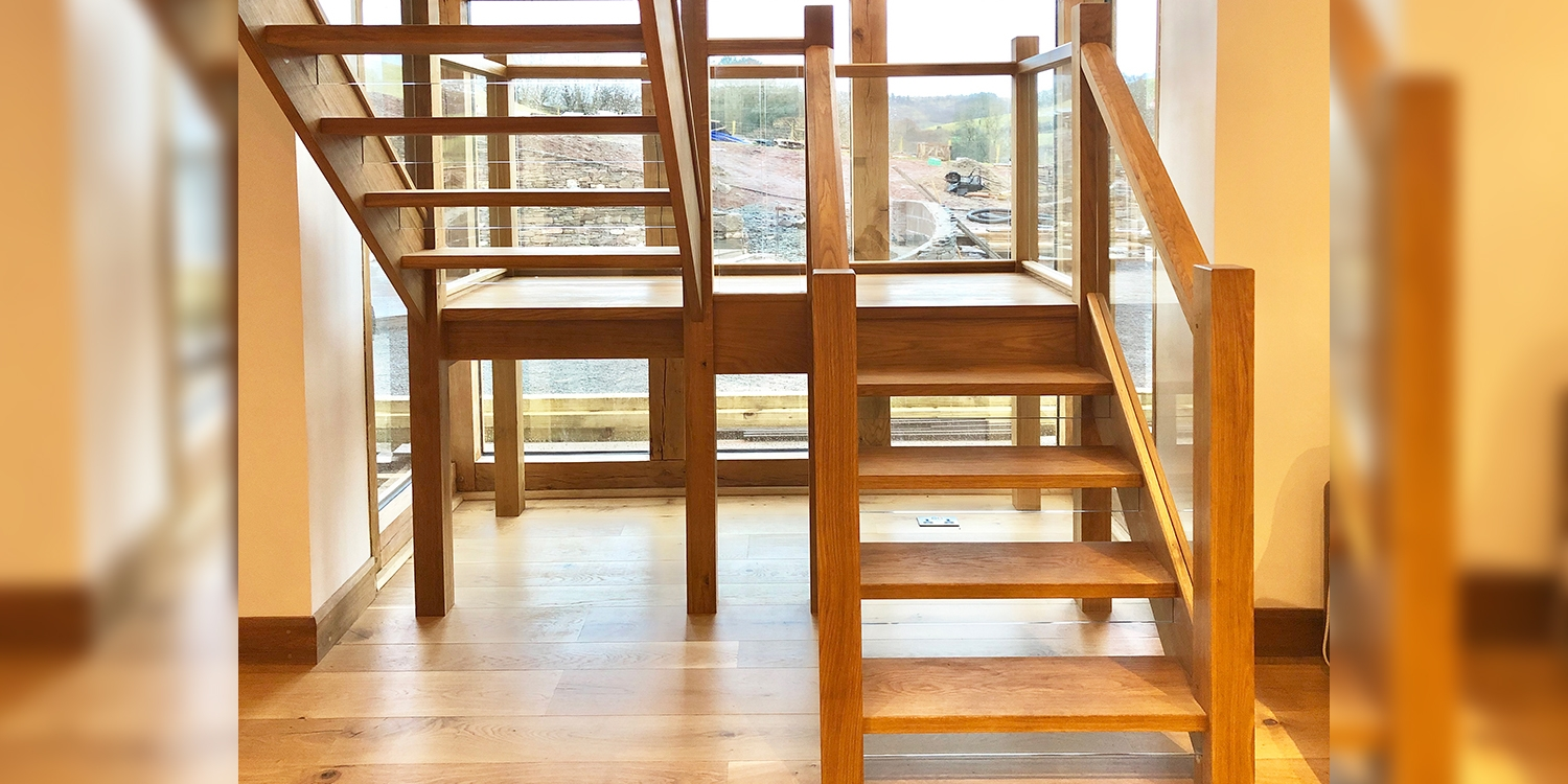 oak and glass staircase, open riser staircase design, wales staircase design, pear stairs
