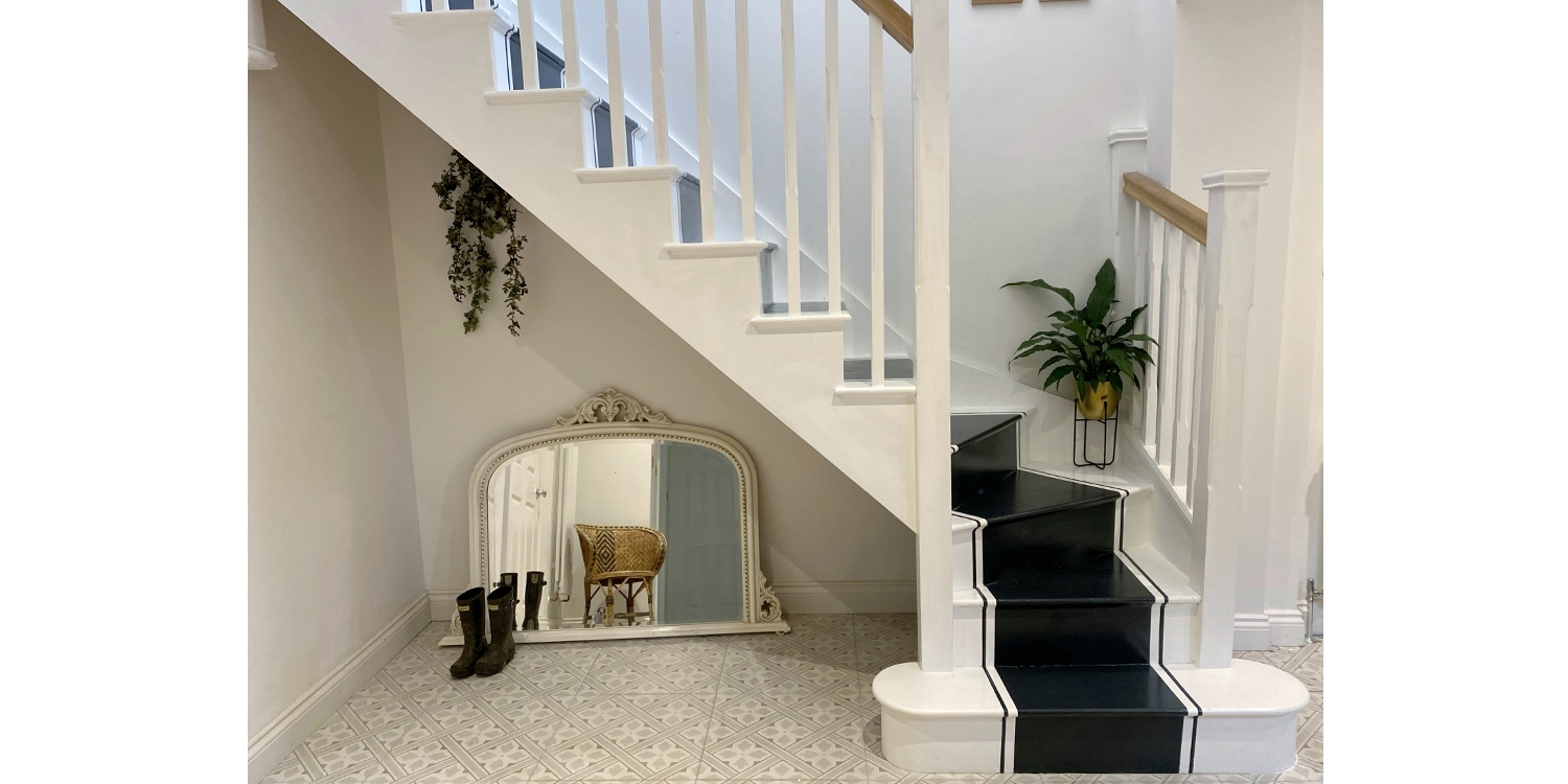 wooden staircase, black paint, white paint