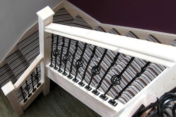Staircase with a striped runner