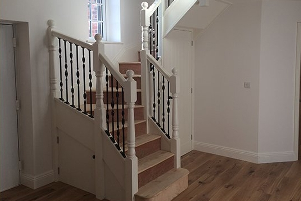 White painted handrails with black metal spindles produce an attractive monochrome staircase