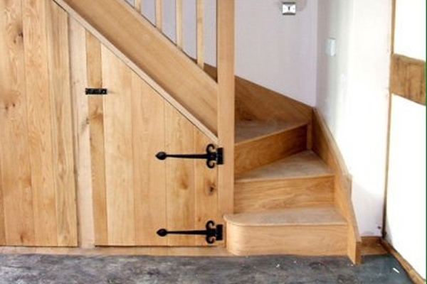 Rustic looking staircase in natural timber with under stair storage