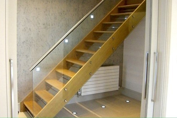 Glass used as balustrading on stairs with wooden treads