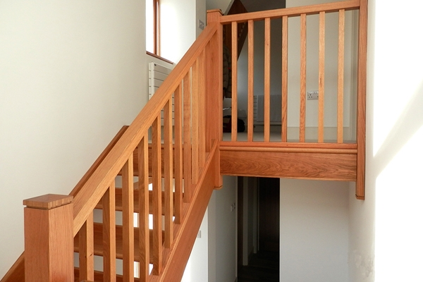 Plain, simple spindles with a simple timber handrail