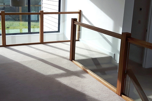 Landing with timber and glass balustrade for style and safety