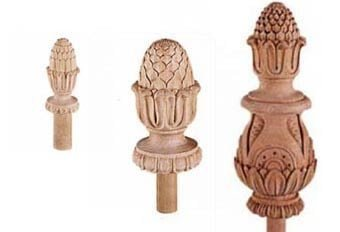Hand-carved pineapple newel caps in limewood