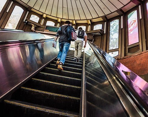 Climbing up escalator